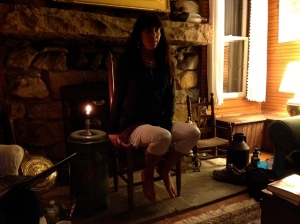 Suzanne last September, leading a workshop reading at the Pond House retreat in front of the fieldstone fireplace.