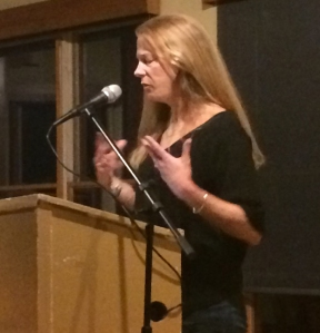 Dede reading her poetry at the Vermont Studio Center in April, 2016. Photo by Mallory Bass.